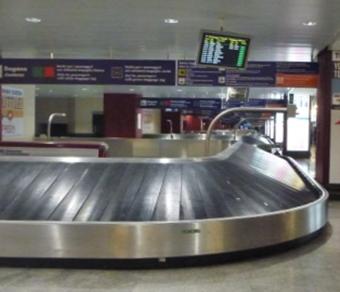 Tapete de recolha de bagagem circular inclinado